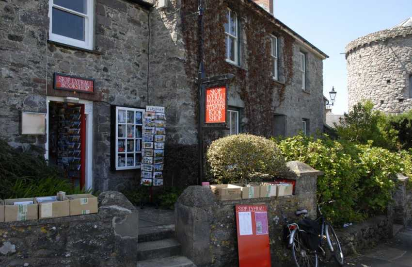 St Davids Book Shop next door to Pebbles House stocks all sorts of literature - special orders are also taken