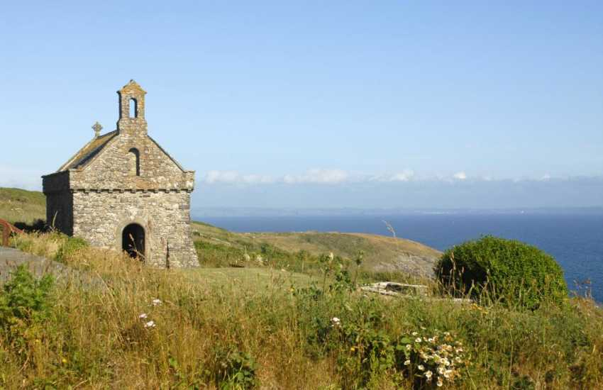 The incredibly peaceful St. Nons Chapel overlooking the sparkling waters of the bay, reached via the coast path only a short walk from St. Davids