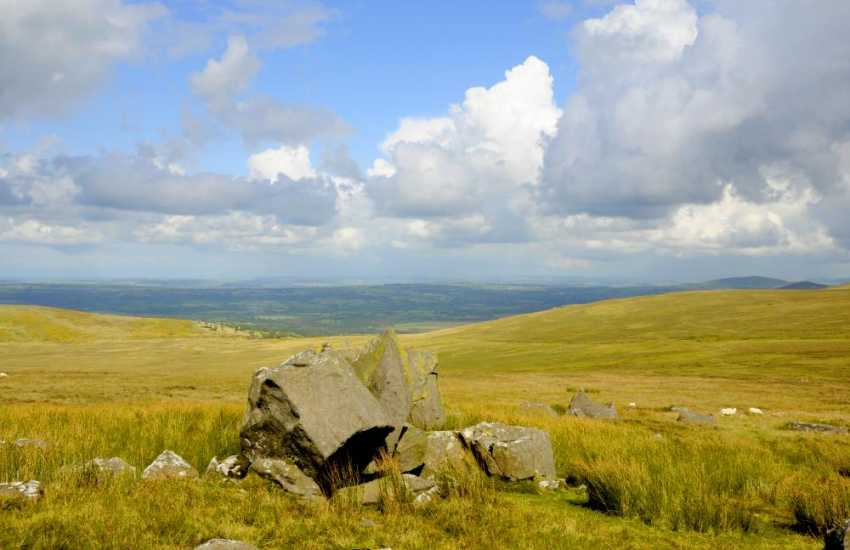 The Preseli Hills wild and mysterious rolling moors are roamed by sheep and ponies and scattered with Neolithic burial chambers, Bronze Age cairns,and Iron Age forts. The famous Bluestones of Stonehenge came from these hills