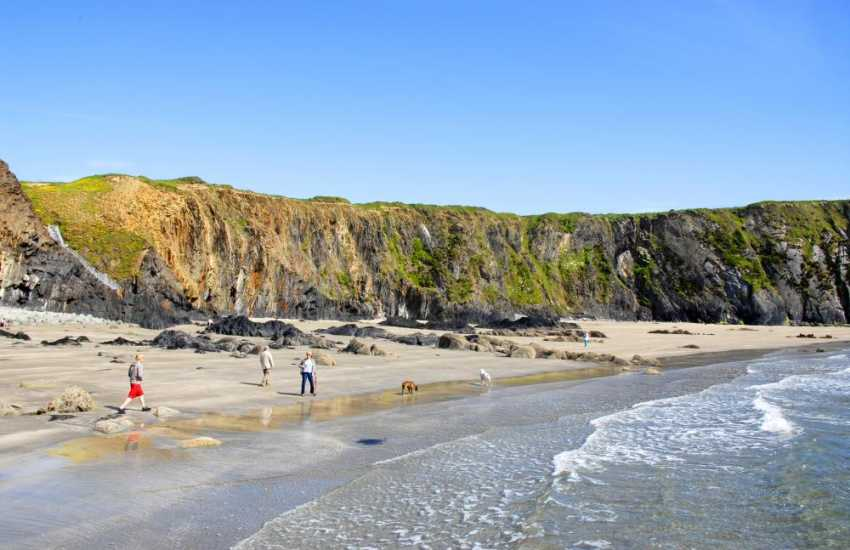 Traeth Llyfn is a remote fine sandy beach backed by towering cliffs between Abereiddy and Porthgain