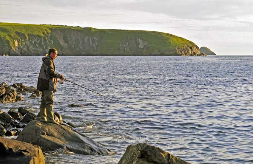 Fishing from the shore at Aberbach Beach