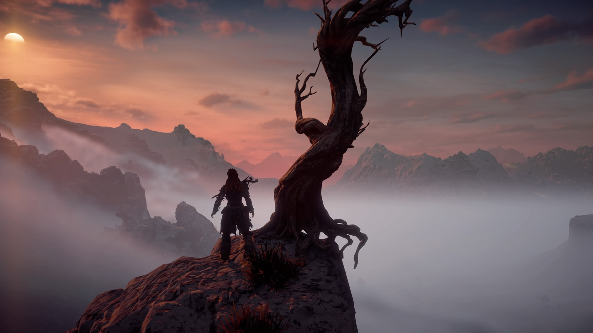Aloy overlooking a misty landscape in Horizon Zero Dawn
