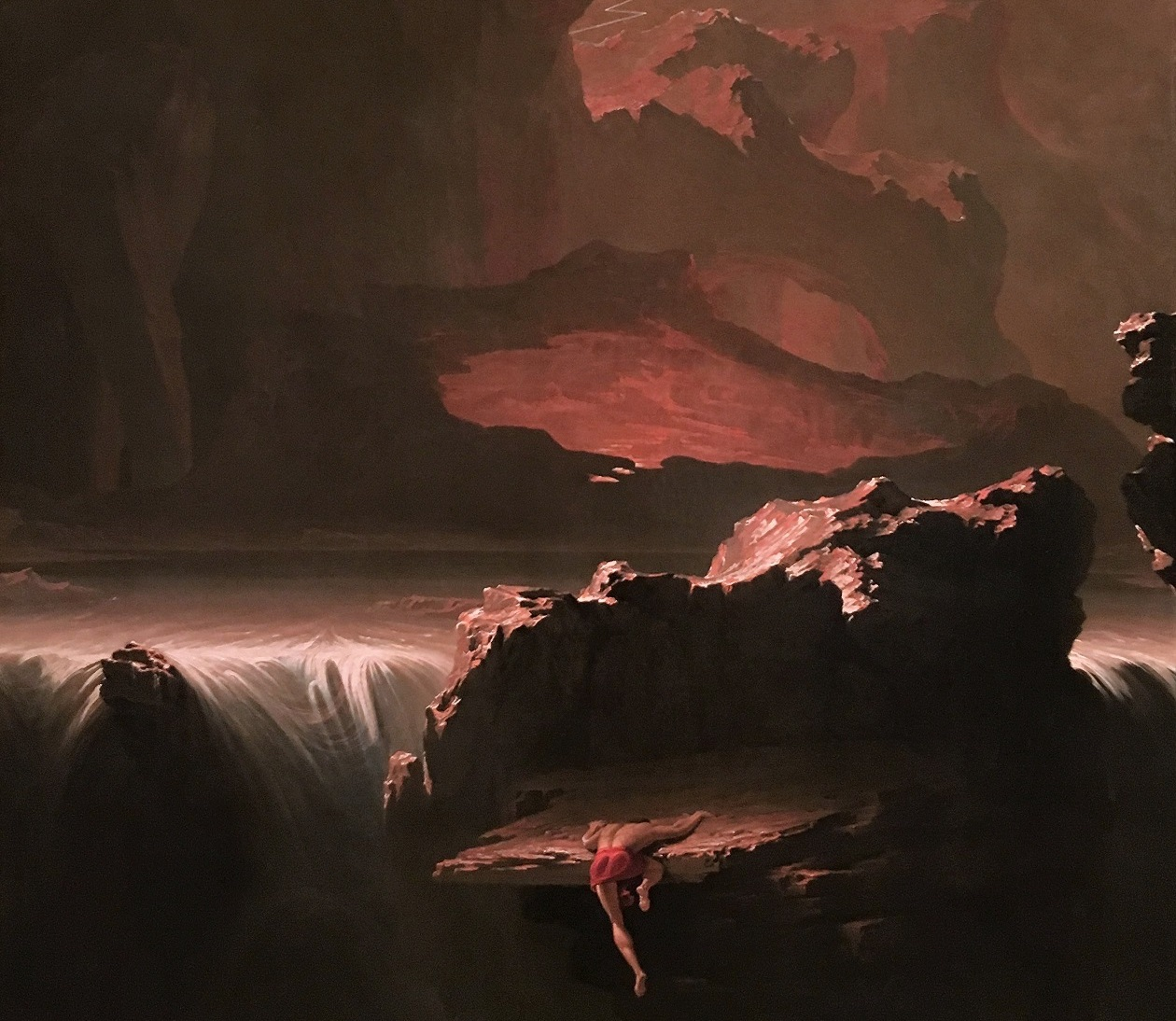 Romantic-era John Martin painting of a figure climbing an enormous mountain