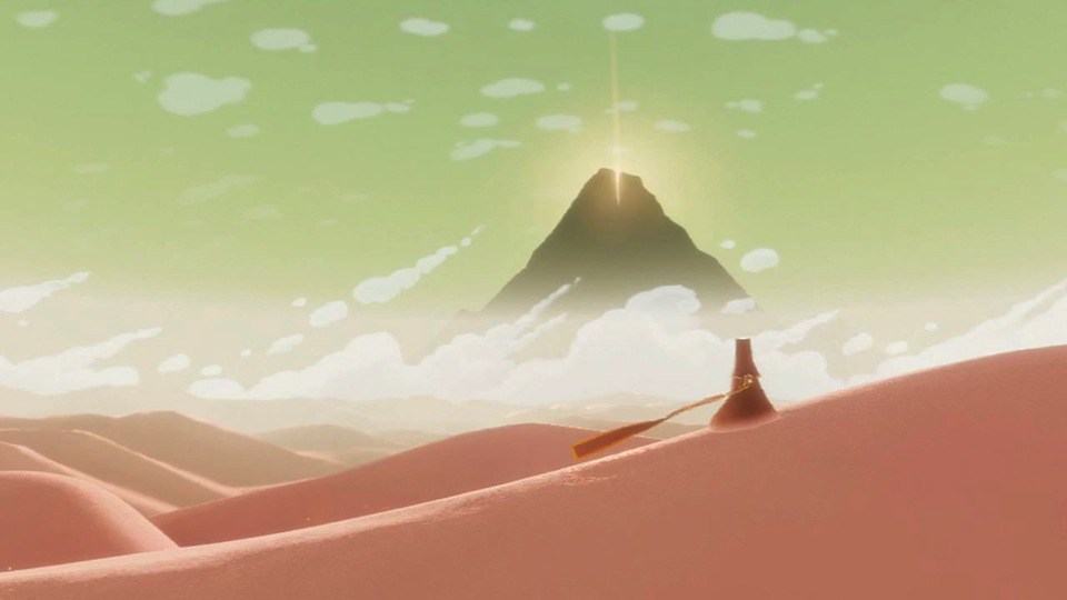 Player character in the game Journey gazing at the massive mountain goal