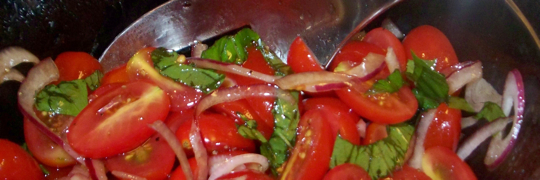 A simple tomato salad is perfect on a hot summer day.