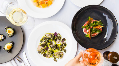 seafood dishes at otto ristorante with wine and aperol spritz