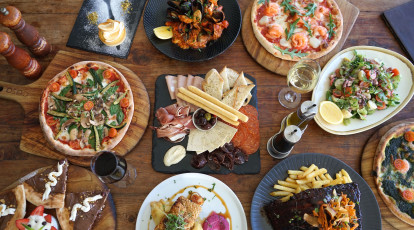 italian dishes of pizza pasta ribs and dessert