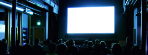 Movie theater texting hero toasty