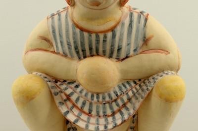 Squatting womain in striped dress front xyruxu
