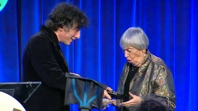 Ursula K Le Guin accepts the the 2014 Medal for Distinguished Contribution to American Letters from fantasy best-seller Neil Gaiman
