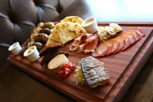 Bell and Whete's food menu, including this charcuterie sampler called Tour de Viande, displays the diversity of the cuisine created by the Normans' European and Mediterranean conquests in the 10th and 11th centuries.