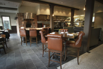 The tall tables in Raven & Rose's dining room offer a view of the wood-fired oven.
