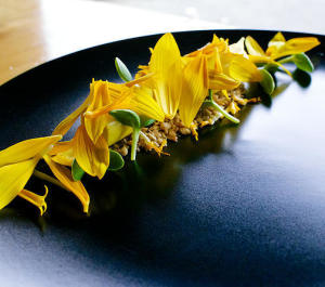 A sunflower-inspired plate from Nomad PDX's August dinner