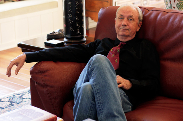 Michael Nesmith sitting on a couch.
