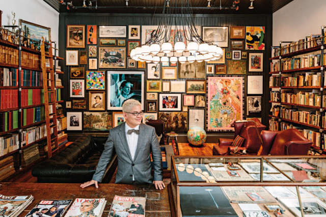 Thomas Lauderdale's library is a cabinet of collections, from '60s-era magazines to pieces by artists like Gus Van Sant and Phyllis Diller. The chandelier is by local designer Jon Hart, and the sofa and chairs are from the boutique Bernadette Breu