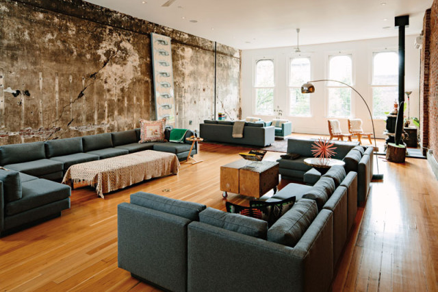 The living room sectional sofa is based on those Iosca designed for Portland's Ace Hotel, and the Andy Warhol silkscreen was a gift from collector and onetime <i>Interview Magazine</i> publisher Paige Powell.