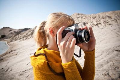 Woman with camera sint rtpzu9