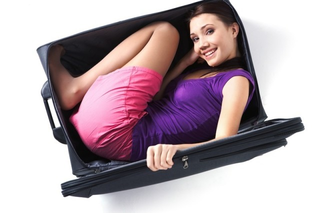 Woman in suitcase ib6f2k