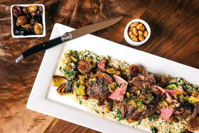 "Levant's signature lamb ""four ways,"" served over couscous and garbanzo beans with brussels sprouts, cipollini onions, and raisins"