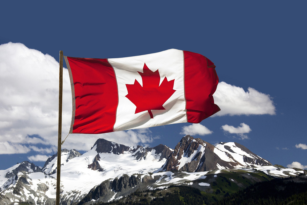 Canada flag over mountains josef hanus gc6sho