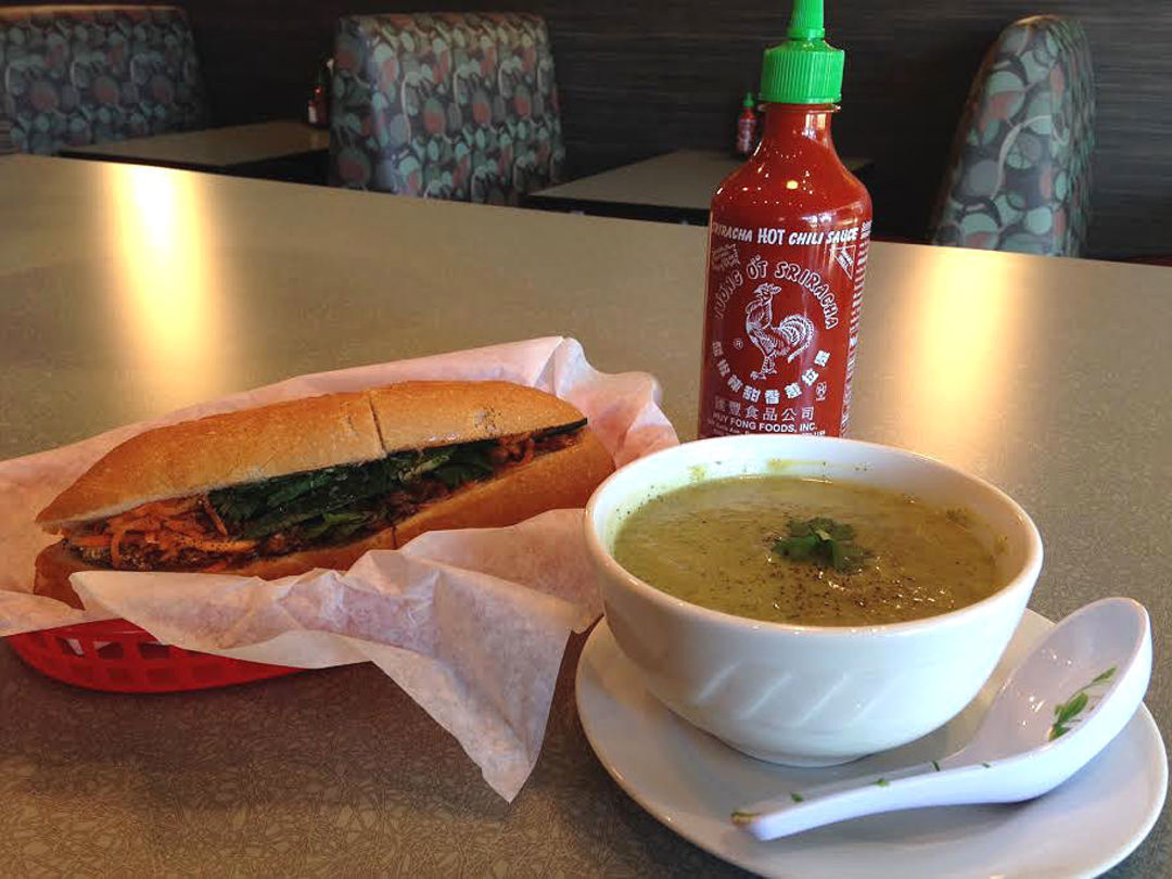 Sardine banh mi with cream of zucchini soup.