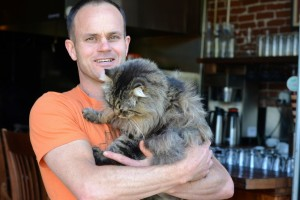Matthew Busetto with Firehouse's resident supercat.