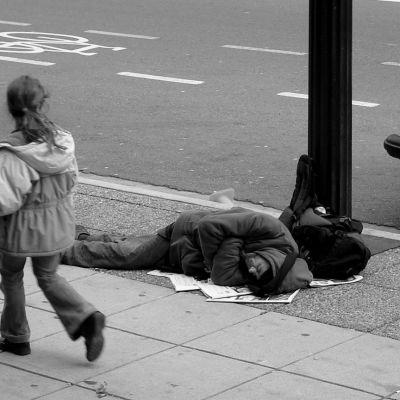 Man sleeping on sidewalk uue8np