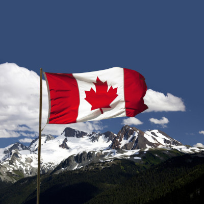 Canada flag over mountains josef hanus gc6sho