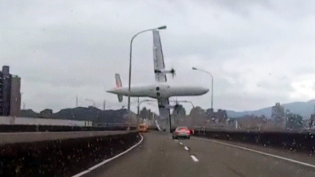 A still image taken from an amateur video shot by a motorist shows a TransAsia Airways plane cartwheeling over a motorway soon after the turboprop ATR 72-600 aircraft took off in New Taipei City