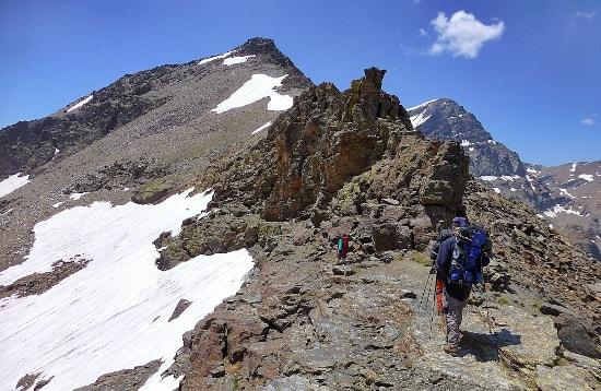 Trekking high peaks of the Sierra Nevada