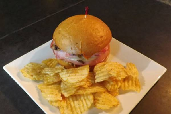 Muffuletta Sandwich, Warm Bread Pudding, and More at Ali's Bar