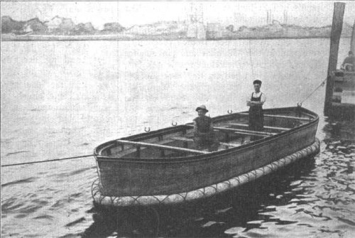 A collapsible lifeboat with the sides up.