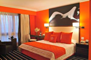 Royal Orchid - Deluxe Orange Room