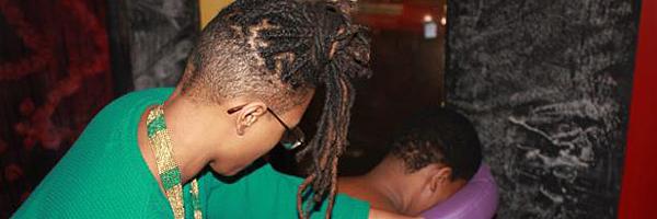 Woman Giving a Back Rub in Newark
