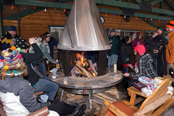 Guests enjoy the fire at the 2013 Suds & Snow Celebration at Timber Ridge