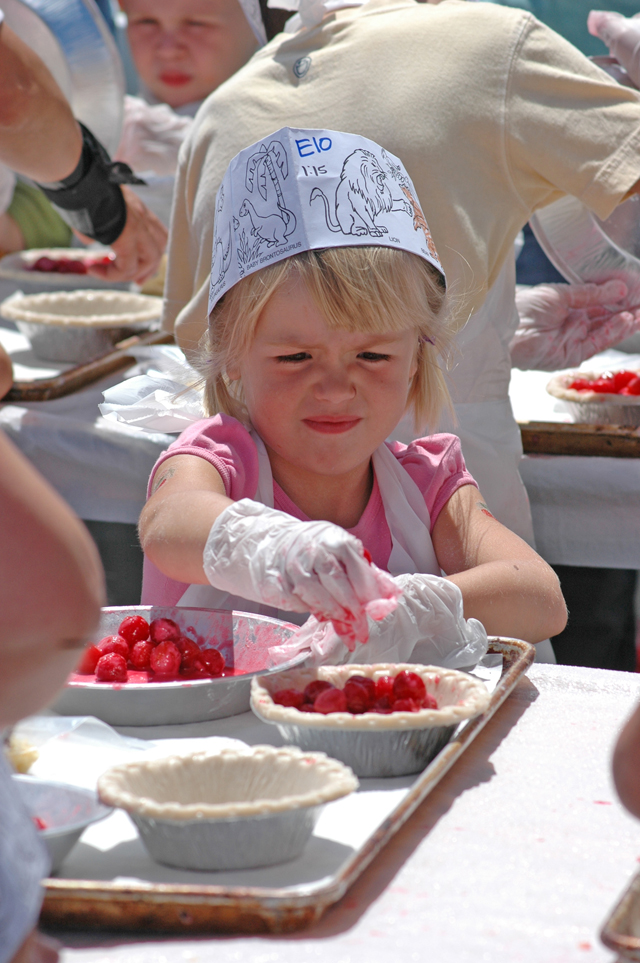 Learning to bake a cherry pie at the Cherry Festival