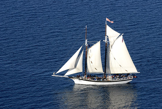 Tall Ship Manitou sailing in West Grand Traverse Bay on a sunny day