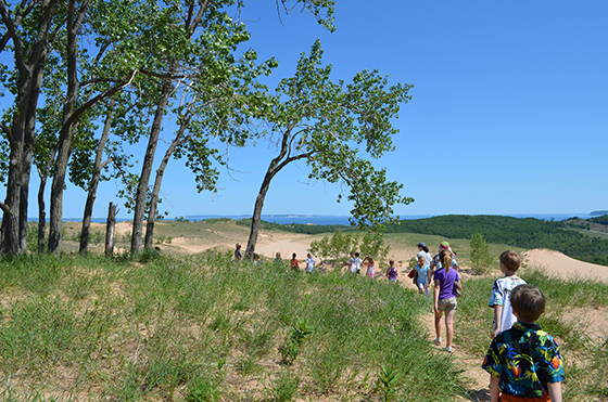 Children hiking along trails within Sleeping Bear Dunes National Lakeshore