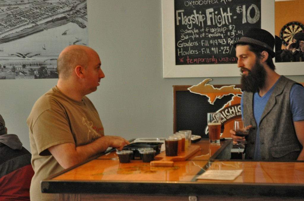 Dustin Jones (r)  leads a customer through a beer/cheese pairing at Brewery Ferment