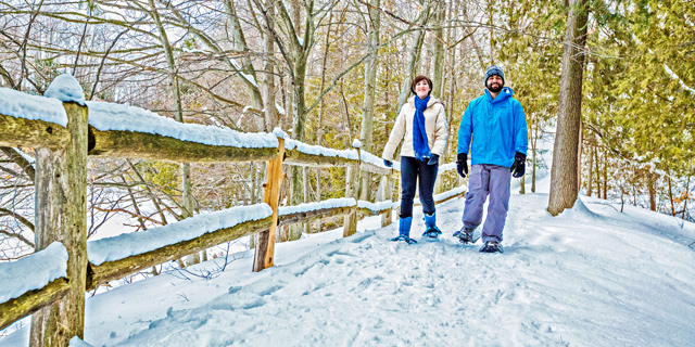 My daughter Liz (and some bearded guy) snowshoeing  near Sabin Pond on the Boardman River.