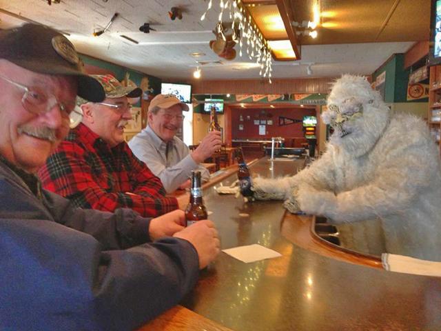 Yeti behind the bar, serving some locals at Eddie's.