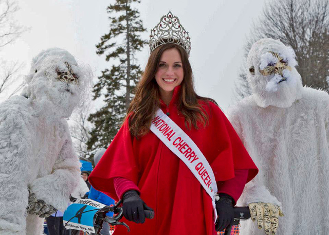 The Yeti-Cherry connection: National Cherry Queen Meg Howard with a pair of Abominables.