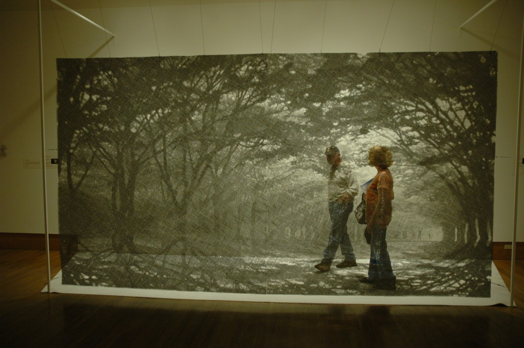 Visitors wander through an illusory forest of layered wire mesh created by Seungmo Park.