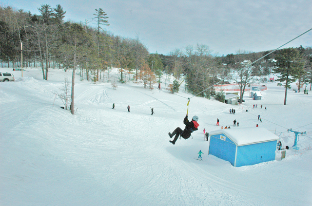 Above the ski slope on the Mt. Holiday zipline.