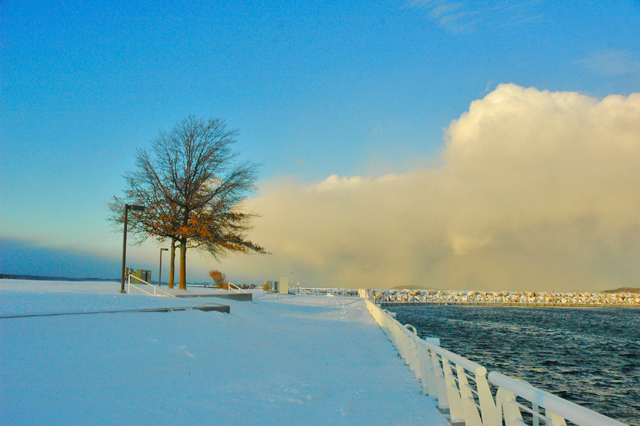 A sunlit Lake Effect storm seen from the Open Space on West Bay