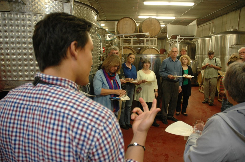 Tour Guide Kyle Brownley makes a point in the cellar