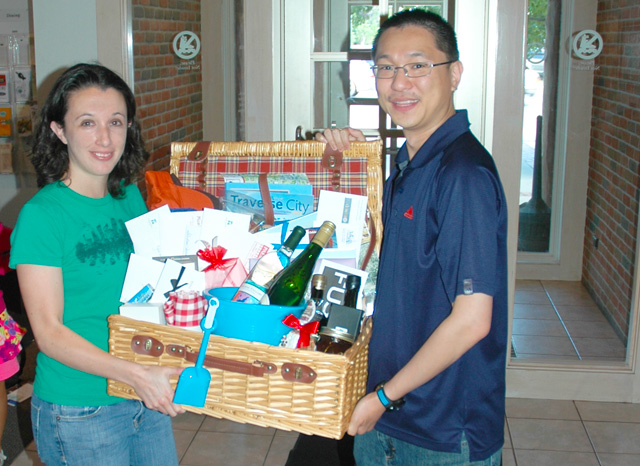 Kacee and Edmund Chung with a basketful of Traverse City goodies.