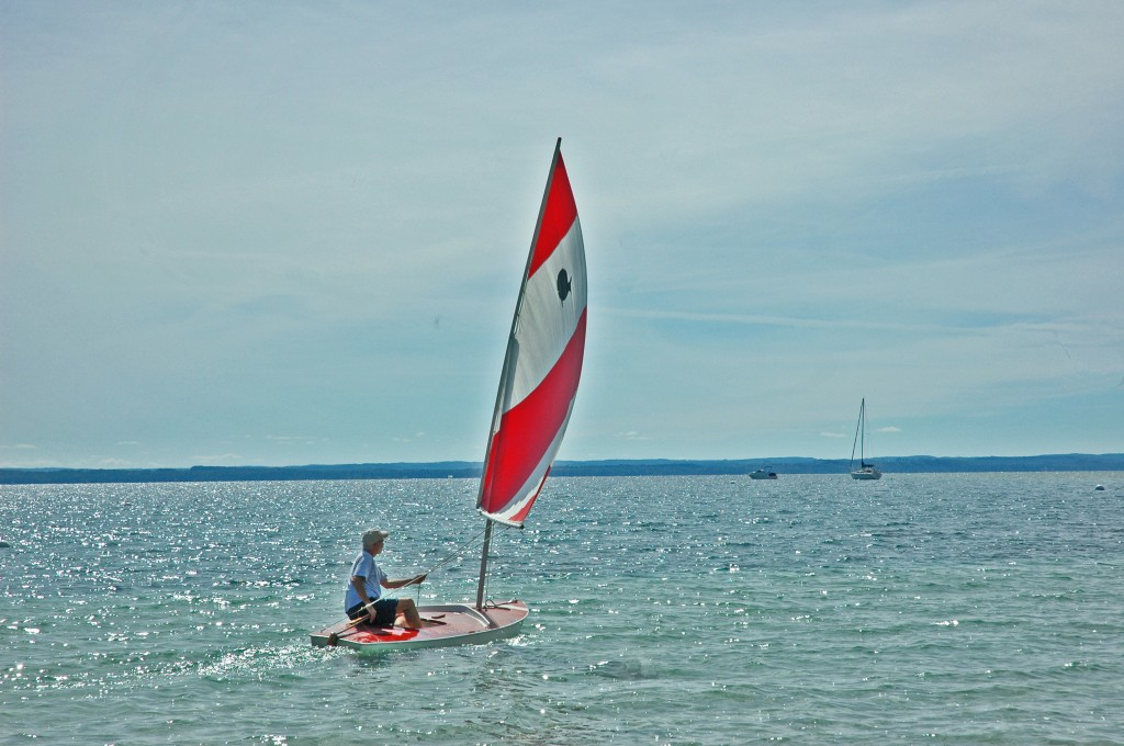 Gliding over the glitter in East Grand Traverse Bay.