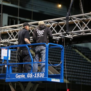 Workers on lift preparing for LiveArts in Grand Rapids