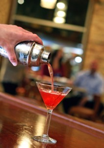 Man pouring cocktail at Bistro Bella Vita in Grand Rapids